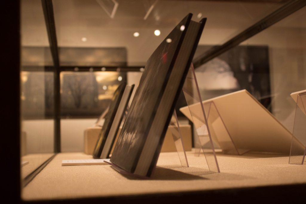 Display of Rocky Schenck art books.