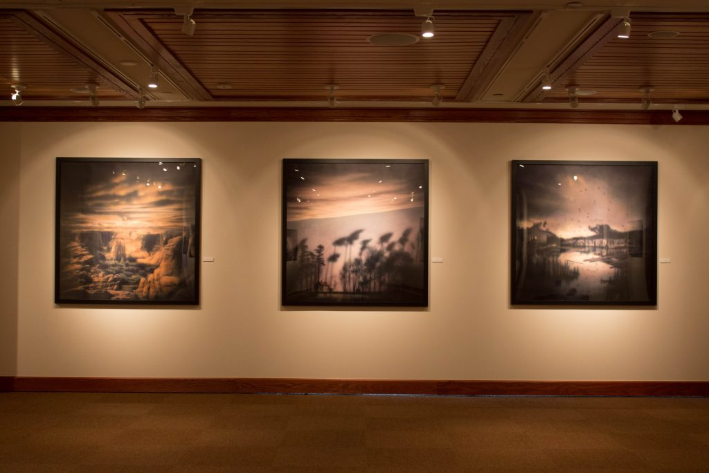"Trio of Rocky Schenck art, left to right: ""Canyon"", ""Lost Again"" and ""Bombay Beach."""