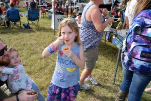 This girl is enjoying her chili at the festival.