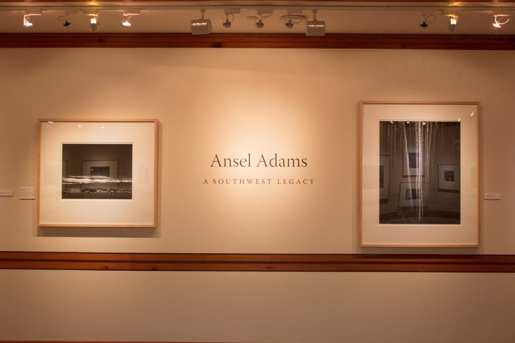 "Welcome to the Ansel Adams exhibition. Left: ""Moonrise, Hernandez, New Mexico"" Right: ""Aspens, Northern New Mexico."""