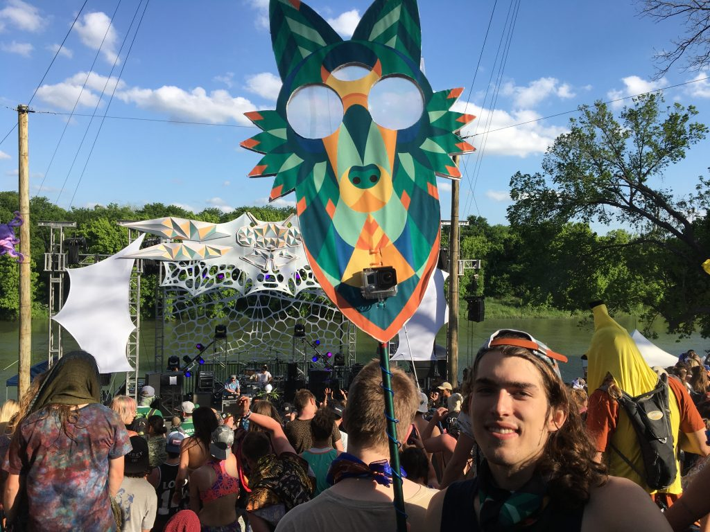 Sean, a 21-year-old from Baltimore, MD, studies Computer Science at Rice University and is shown here dancing with his home-made Euphoria totem at the Dragonfly Stage.