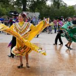 Dancers from Ballet Folkloríco Dance Co. perform in front of the main stage at the Día De Los Muertos event at the Emma S. Barrientos Mexican American Cultural Center (MACC) in Austin, Texas, Oct. 21.