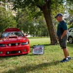 Pete Luera admires his 2002 Roush Mustang. According to Luera, only 28 out of 10,000 were made in the color. He keeps the car in his garage and only takes out for special occasions like the Día De Los Muertos event at the MACC. He has made quite a few modifications to the car, like the LED lighting in the wheels and a new video and sound system.
