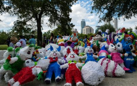 A pile of piñatas awaiting their demise at the hands of children attending the Día De Los Muertos event at the MACC. Part of the Austin skyline looms in the background.