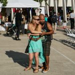 Lauren Sears and Eric Cortez dance and embrace during one of the conjunto music performances. They have come to this event every year since it was started 10 years ago. Cortez was especially appreciative of the mission and meaning of the MACC in preserving Hispanic culture. He pointed out that the controversial development of the surrounding Rainey district, once a residential neighborhood now turned into a destination for drinking and tourism, stops at the MACC.