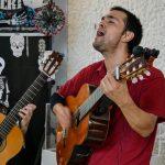 Javier Jara of Los Bohemios Perdidos performs in the display room of the Día De Los Muertos altars.