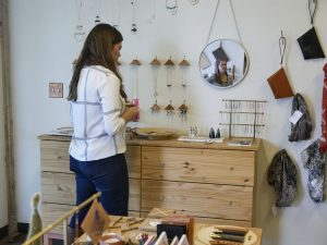 At Son of a Sailor's storefront in Canopy, shoppers review some of the handmade and curated goods available for sale.