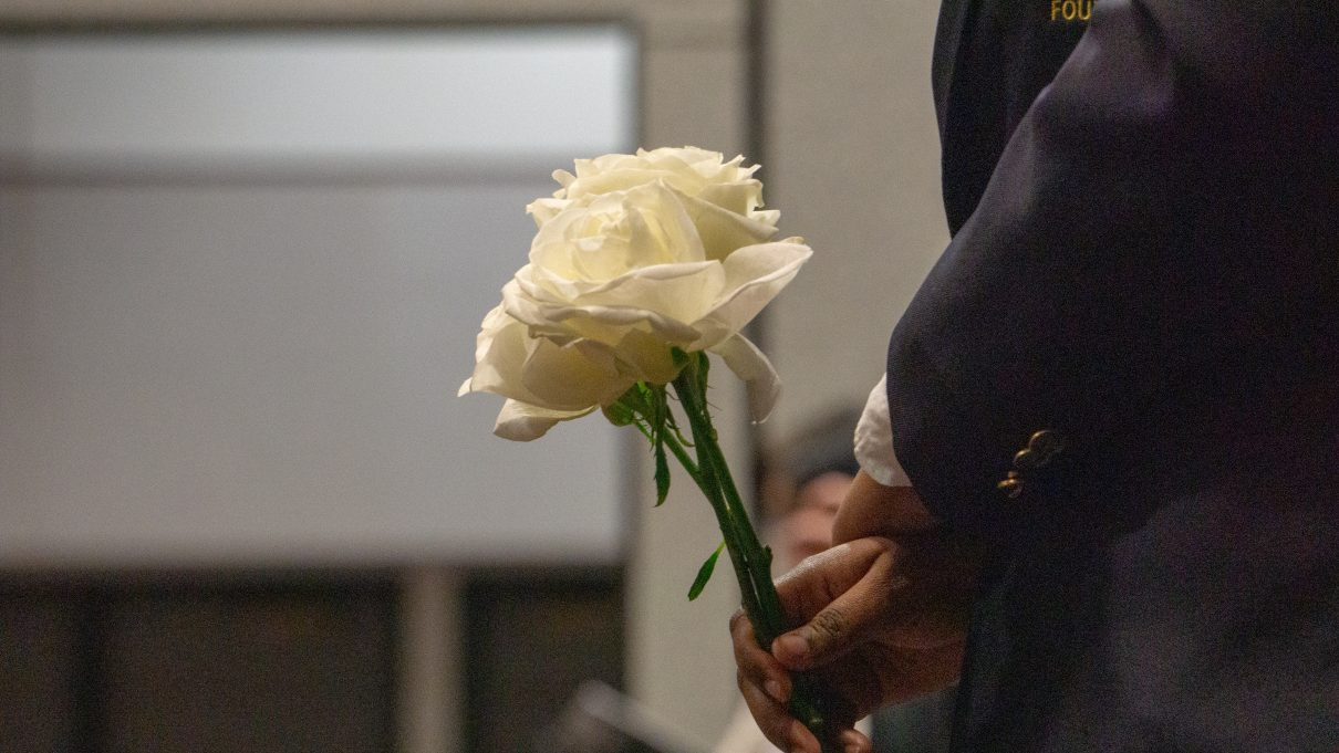 As a part of a long-stranding tradition, friends and family that stand as an honoree is named were given long-stemmed white roses by a Student Foundation member.Photo by Sawyer Click