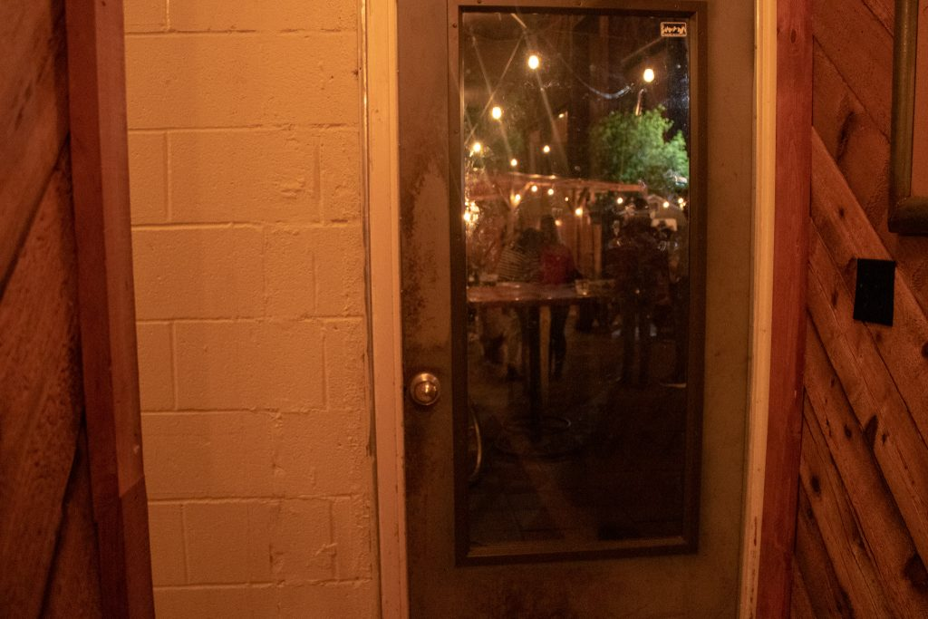 Door leading to the outside patio at Buzzmill