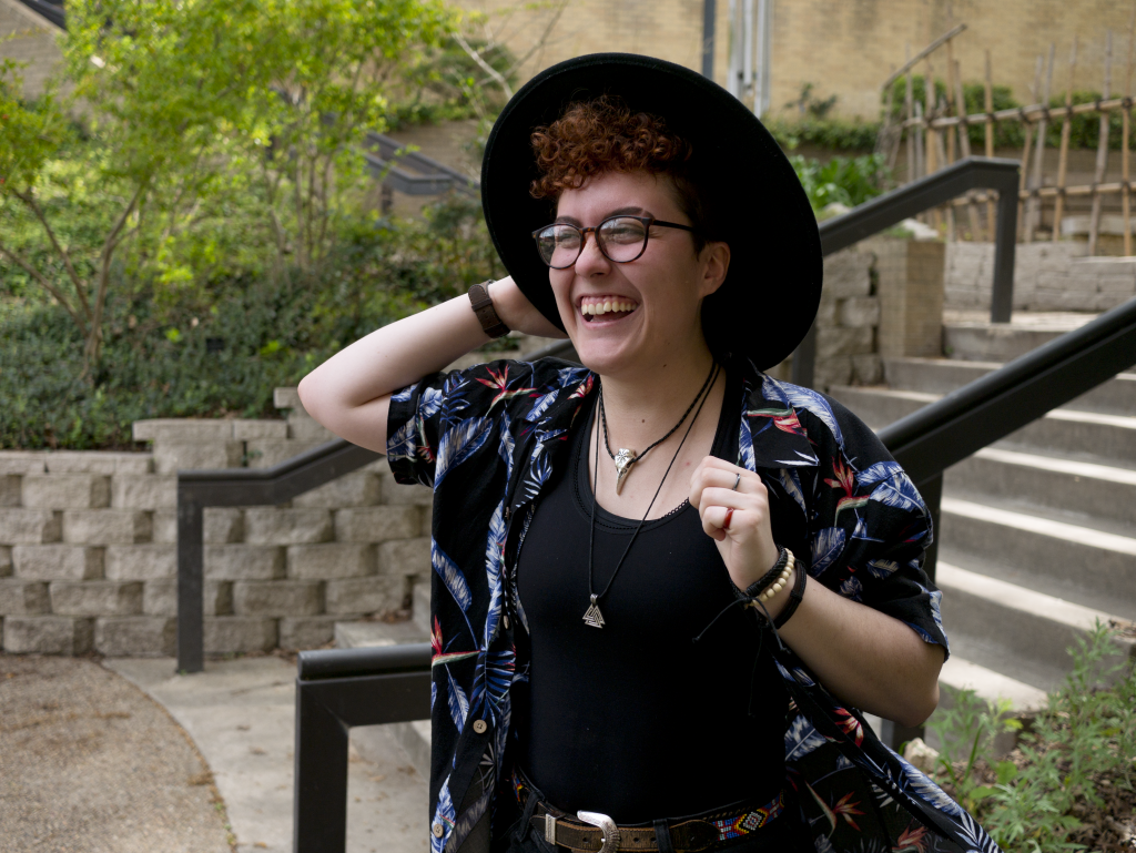 A person in a wide brimmed hat smiling